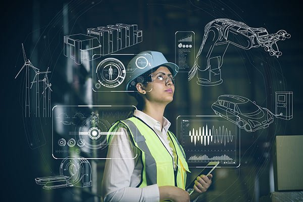 Worker with tablet and graphics of multiple industry icons